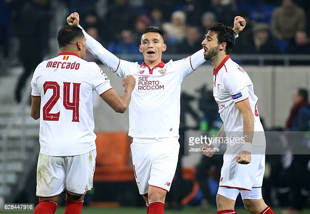 Matias Kranevitter of Sevilla FC celebrates between Gabriel Mercado and Nicolas Pareja following the UEFA Champions League match between Olympique...
