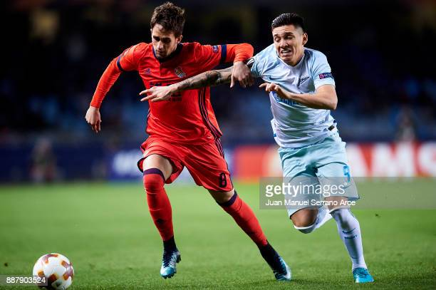 Matias Kranevitter of Zenit St Petersburg duels for the ball with Adnan Januzaj of Real Sociedad during the UEFA Europa League group L football match...