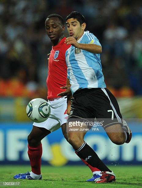 Matias Laba of Argentina fails to score past Saido Berahino of England during the FIFA U20 World Cup Colombia 2011 group F match between Argentina...