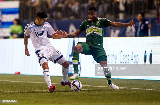 Matias Laba of the Vancouver Whitecaps FC battles with Alvas Powell of the Portland Timbers for the ball in MLS action on March 2015 at BC Place...