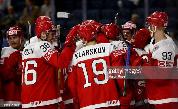 Matias Lassen of Denmark celebrate with his team mates after the 2017 IIHF Ice Hockey World Championship game between Denmark and Italy at Lanxess...