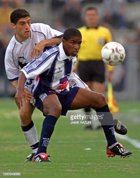 Matias Licht of Gimnasia y Esqrima and Jefferson Farfan of Alianza Lima in action during Copa LIbertadores action 26 March 2003 in Lima El jugador...