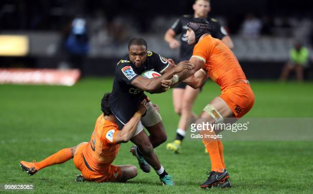 Matias Moroni and Juan Manuel Leguizamon of the Jaguares tackling Lukhanyo Am of the Cell C Sharks during the Super Rugby match between Cell C Sharks...