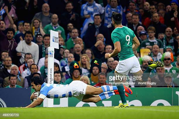 Matias Moroni of Argentina dives over the line to score the first try during the 2015 Rugby World Cup Quarter Final match between Ireland and...