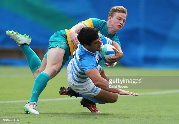 Matias Moroni of Argentina scores a try during the Men's Rugby Sevens placing 58 match between Argentina and Australia on Day 6 of the Rio 2016...