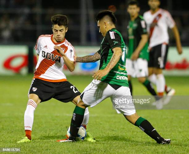 Matias Moya of River Plate fights for the ball with Emiliano Aguero of San Martin during a match between San Martin de San Juan and River Plate as...