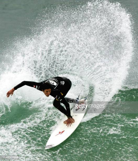 Matias Mulanovich of Peru performs a backhand slash as he placed second in his heat to advance to round three of the Quiksilver ISA World Junior...