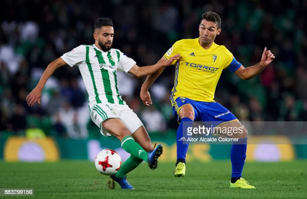 Matias Nahuel of Real Betis duels for the ball with David Barral of Cadiz during the Copa del Rey Round of 32 Second Leg match between Real Betis...