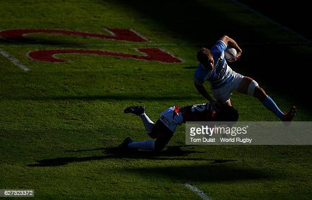 Matias Ocsaduk of Argentina is tackled by Keiju Tsuruta of Japan during day three of the Emirates Dubai Rugby Sevens HSBC Sevens World Series match...