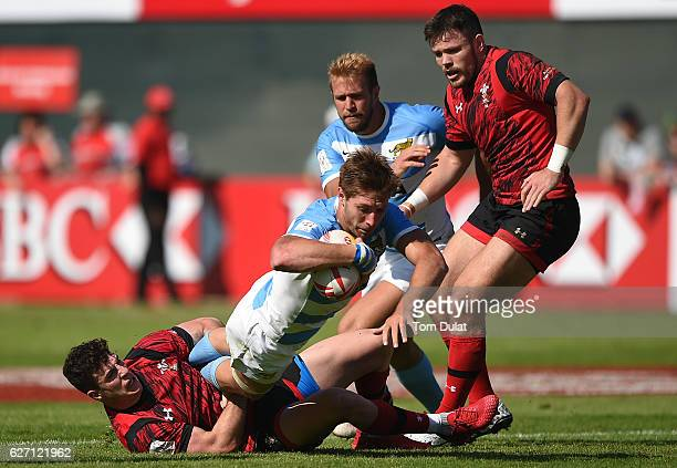 Matias Ocsaduk of Argentina is tackled by Owen Jenkins of Wales during day two of the Emirates Dubai Rugby Sevens HSBC Sevens World Series match...