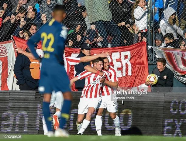 Matias Pellegrini of Estudiantes celebrates with teammates after scoring the second goal of his team during a match between Estudiantes and Boca...