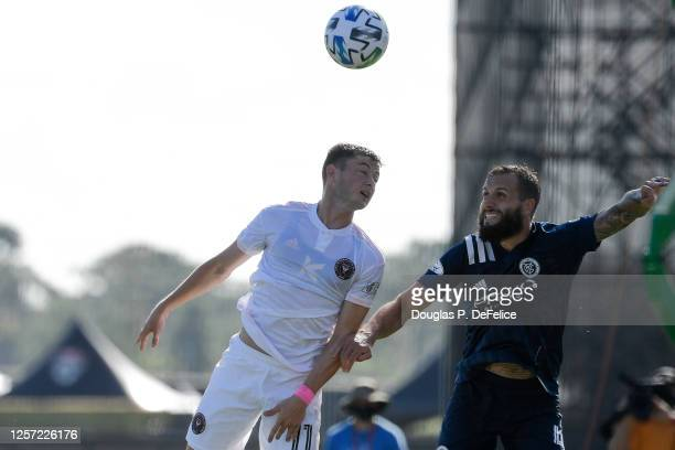Matias Pellegrini of Inter Miami CF and Maxime Chanot of New York City FC fight for a header during the first half in the MLS is Back Tournament at...
