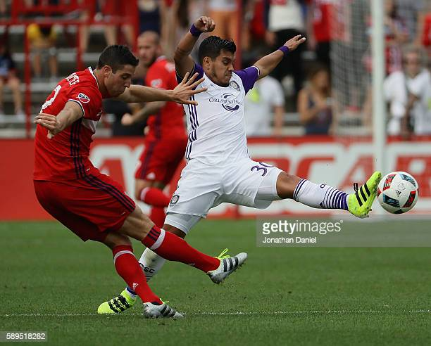 Matias Perez Garcia of Orlando City FC blocks a pass by Matt Polster of Chicago Fire during an MLS match at Toyota Park on August 14 2016 in...