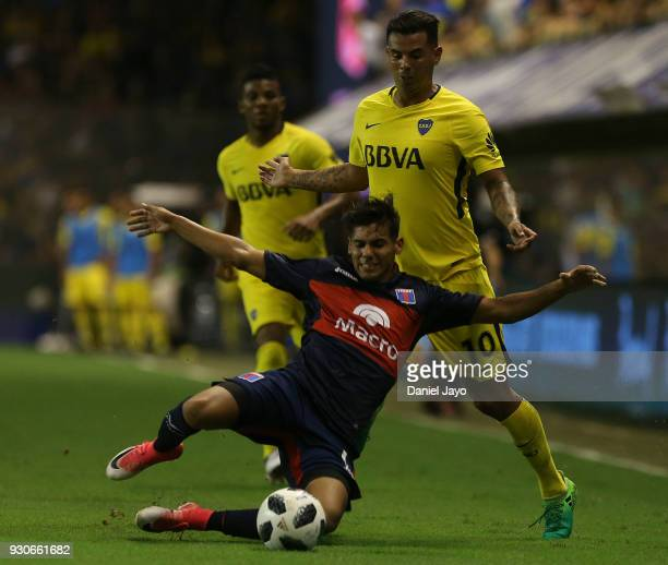 Matias Perez Garcia of Tigre is tackled by Edwin Cardona of Boca Juniors during a match between Boca Juniors and Tigre as part of the Superliga...