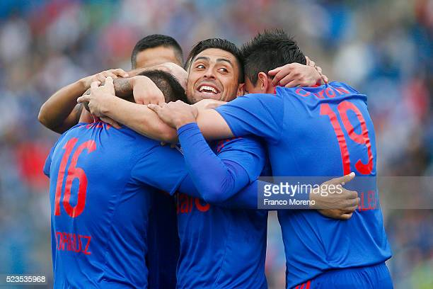 Matias Rodriguez of U de Chile celebrates with his teammates after scoring the first goal against U Catolica during a match between U Catolica and U...