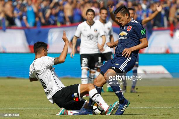 Matias Rodriguez of U de Chile fights for the ball with Juan Manuel Insaurralde of Colo Coloduring a match between U de Chile and Colo Colo as part...