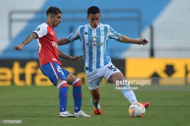 Matias Rojas of Racing Club controls the ball during a group F match of Copa CONMEBOL Libertadores 2020 between Racing and Nacional at Juan Domingo...