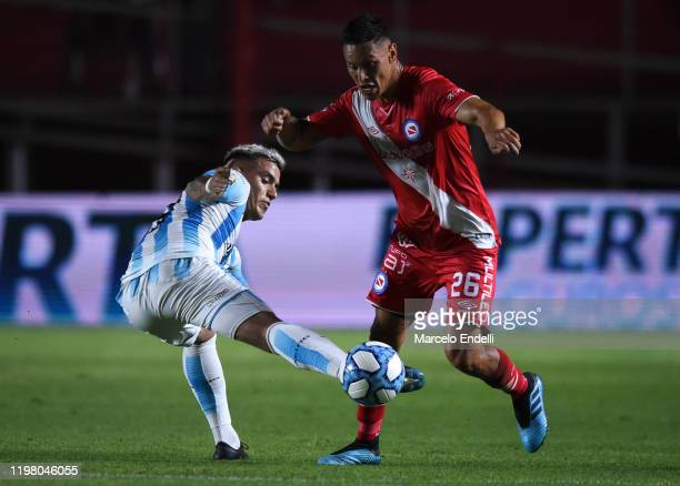 Matias Romero of Argentinos Juniors fights for the ball with Leonel Miranda of Racing Club during a match between Argentinos Juniors and Racing Club...