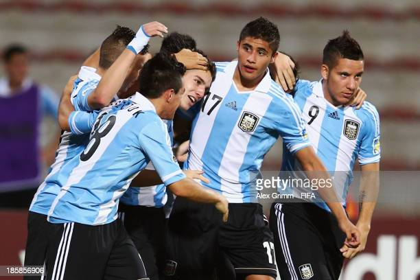 Matias Sanchez of Argentina celebrates his team's second goal with team mates during the FIFA U-17 World Cup UAE 2013 Group E match between Argentina...