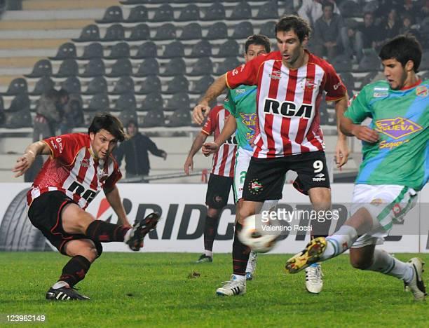 Matias Sanchez of Estudiantes kicks the ball to score against Arsenal as part of the 2011 Copa Bridgestone Sudamericana at Ciudad de La Plata Stadium...
