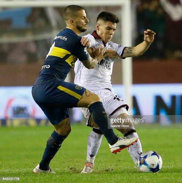 Matias Sanchez of Lanus fights for the ball with Dario Benedetto of Boca Juniors during a match between Lanus and Boca Juniors as part of the...
