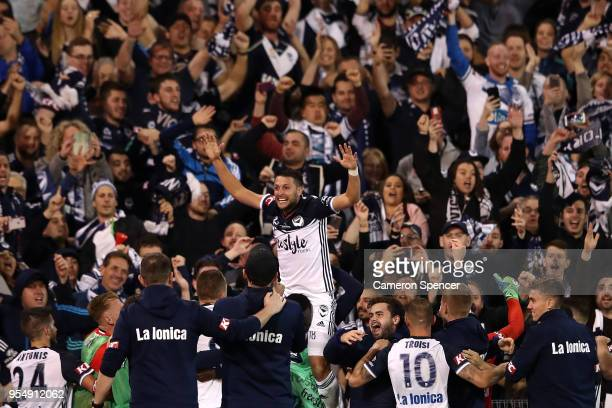 Matias Sanchez of the Victory and team mates celebrate winning the 2018 ALeague Grand Final match between the Newcastle Jets and the Melbourne...