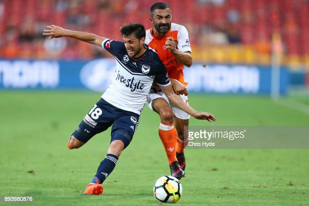 Matias Sanchez of Victory and Fahid Ben Khalfallah of Roar compete for the ball during the round 11 ALeague match between the Brisbane Roar and the...