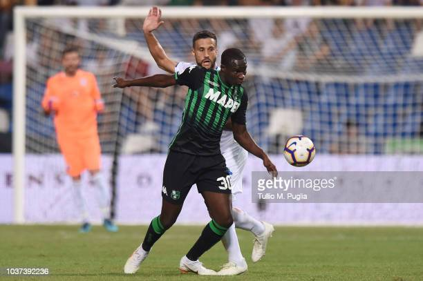 Matias Silvestre of Empoli and Khouma Babacar of Sassuolo compete for the ball during the serie A match between US Sassuolo and Empoli at Mapei...
