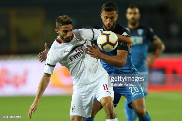 Matias Silvestre of Empoli FC fights for the ball with Fabio Borini of AC Milan during the serie A match between Empoli and AC Milan at Stadio Carlo...