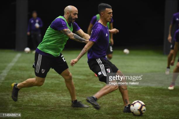 Matias Suarez and Javier Pinola of River Plate during a training session at CAT Alfredo Gottardi on May 21 2019 in Curitiba Brazil River Plate will...
