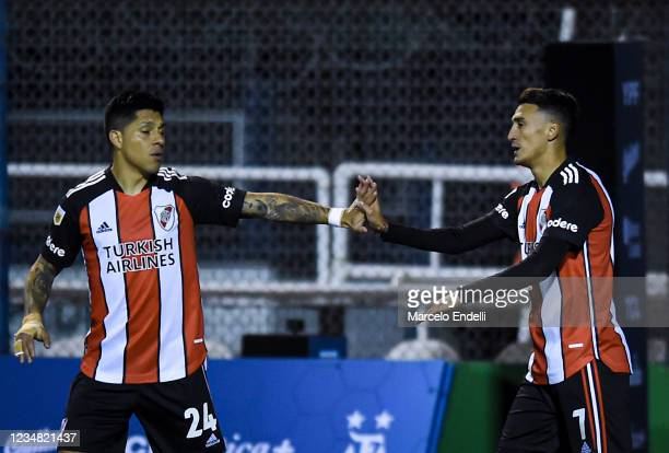 Matias Suarez of River Plate celebrates with teammate Enzo Perez after scoring the first goal of his team during a match between Gimnasia Esgrima La...