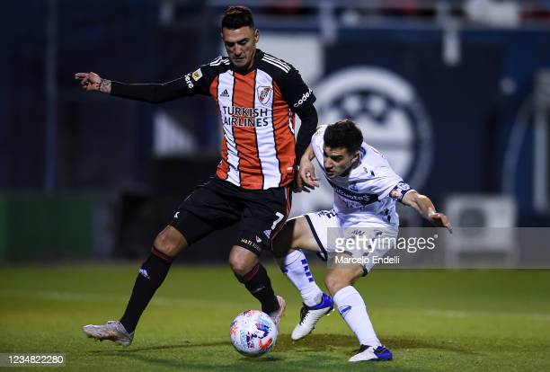 Matias Suarez of River Plate fights for the ball with Matias Melluso of Gimnasia La Plata during a match between Gimnasia Esgrima La Plata and River...