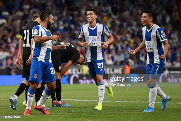 Matias Vargas of Espanyol celebrates with teammates Marc Roca and Wu Lei after scoring his team's third goal during the UEFA Europa League Play Off...
