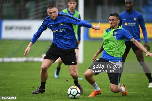 Matias Vecino and Milan Skriniar of FC Internazionale compete for the ball during the FC Internazionale training session at the club's training...