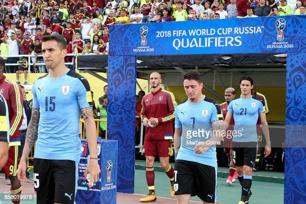 Matias Vecino Cristian Rodriguez and Edinson Cavani of Uruguay get in the field prior a match between Venezuela and Uruguay as part of FIFA 2018...