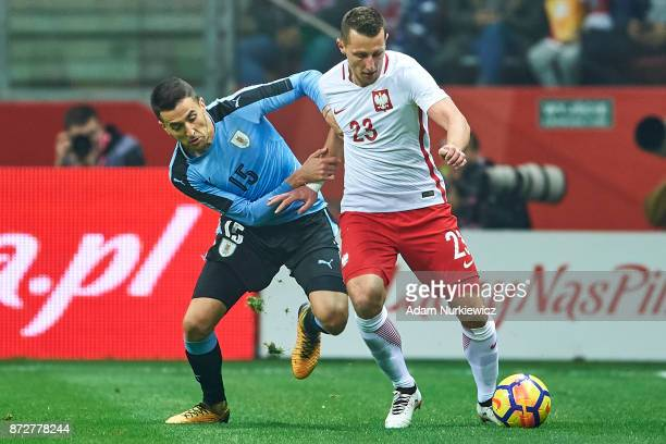 Matias Vecino from Uruguay fights for the ball with Kamil Wilczek from Poland while Poland v Uruguay International Friendly soccer match at National...
