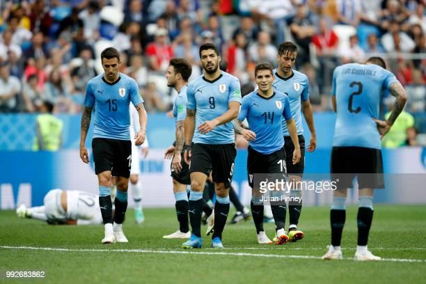 Matias Vecino, Luis Suarez, Lucas Torreira and Jose Gimenez of Uruguay look on during the 2018 FIFA World Cup Russia Quarter Final match between...