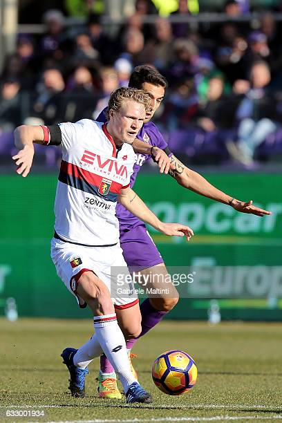 Matias Vecino of ACF Fiorentina battles for the ball with Oscar Hiljemark of Genoa CFC during the Serie A match between ACF Fiorentina and Genoa CFC...