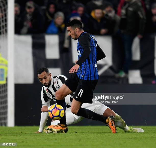 Matias Vecino of FC Internazionale and Medhi Benatia of Juventus FC compete for the ball during the Serie A match between Juventus and FC...