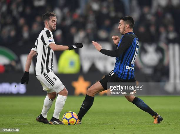 Matias Vecino of FC Internazionale and Miralem Pjanic of Juventus FC compete for the ball during the Serie A match between Juventus and FC...