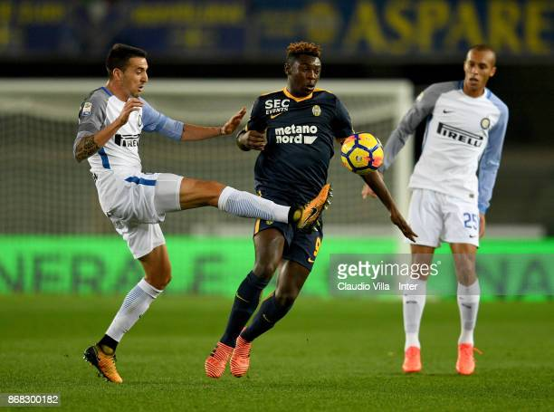 Matias Vecino of FC Internazionale and Moise Kean of Hellas Verona FC compete for the ball during the Serie A match between Hellas Verona FC and FC...