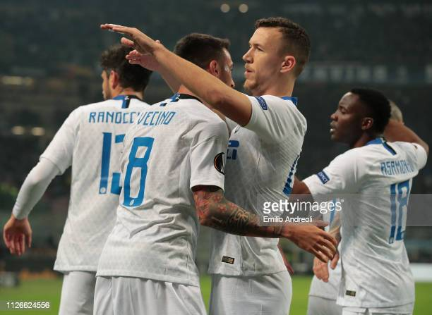 Matias Vecino of FC Internazionale celebrates with his teammate Ivan Perisic after scoring the opening goal during the UEFA Europa League Round of 32...
