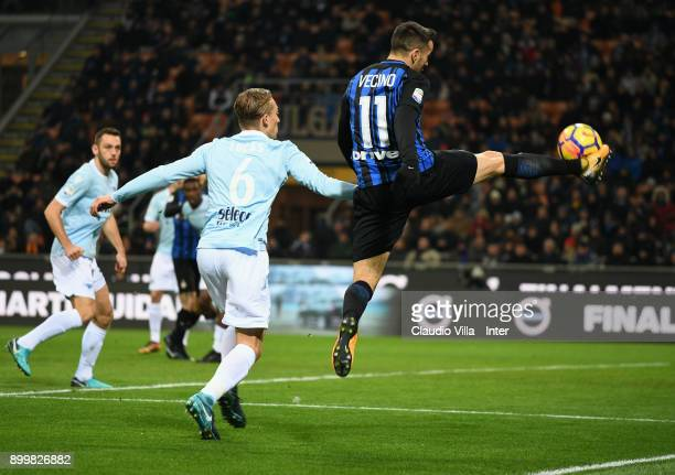 Matias Vecino of FC Internazionale competes for the ball with Lucas Leiva of SS Lazio during the serie A match between FC Internazionale and SS Lazio...