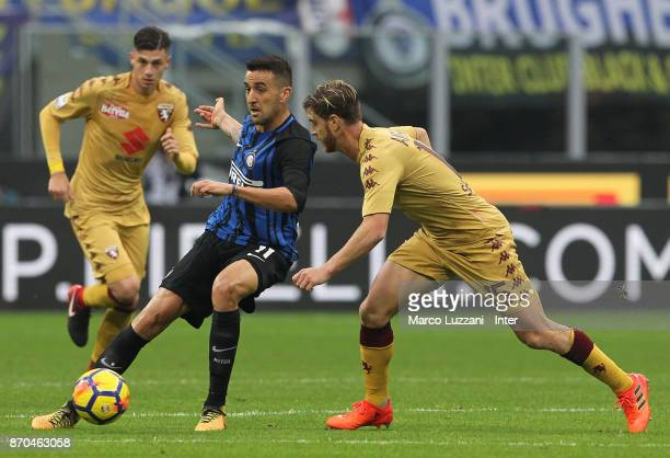 Matias Vecino of FC Internazionale competes for the ball with Cristian Ansaldi of Torino FC during the Serie A match between FC Internazionale and...