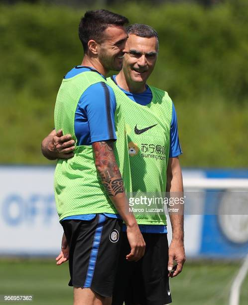 Matias Vecino of FC Internazionale embraces Giuseppe Bergomi of Inter Forever during the FC Internazionale training session at the club's training...