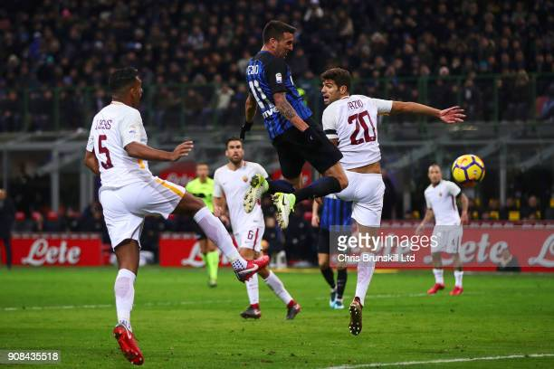 Matias Vecino of FC Internazionale heads his side's first goal during the Serie A match between FC Internazionale and AS Roma at Stadio Giuseppe...