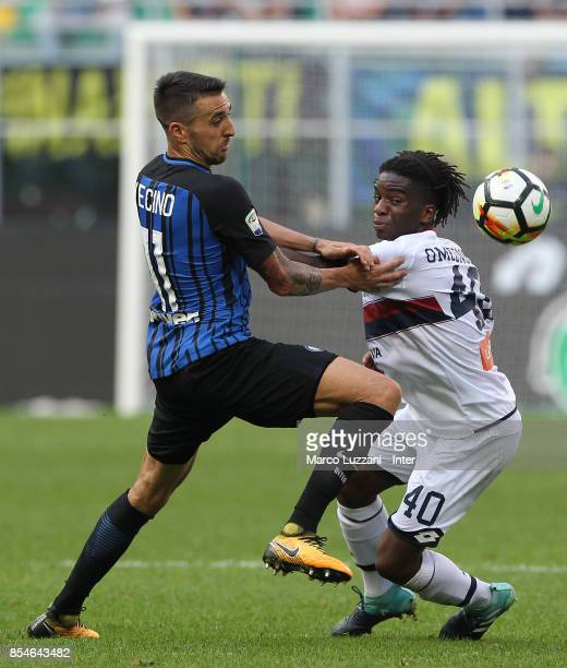 Matias Vecino of FC Internazionale ichallenges for the ball Stephane Omeonga of Genoa CFC during the Serie A match between FC Internazionale and...