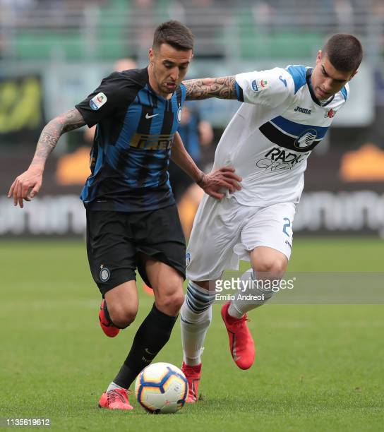 Matias Vecino of FC Internazionale is challenged by Gianluca Mancini of Atalanta BC during the Serie A match between FC Internazionale and Atalanta...