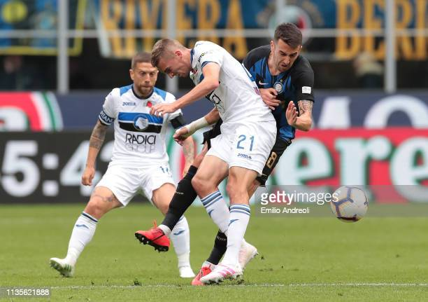 Matias Vecino of FC Internazionale is challenged by Timothy Castagne of Atalanta BC during the Serie A match between FC Internazionale and Atalanta...