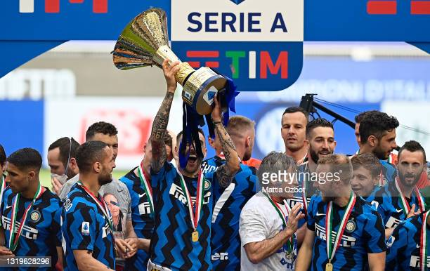 Matias Vecino of FC Internazionale lifts the Serie A trophy as his team mates celebrate after the Serie A match between FC Internazionale Milano and...